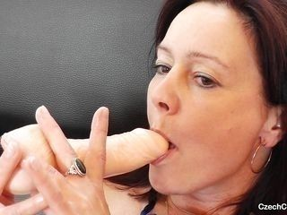 hot cougar masturbating with dildo
